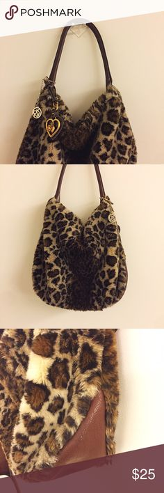 Pre-loved DKNY Leopard Bag Item: DKNY Leopard Bag   Brand: DKNY  Color: Leopard  Size: One Size  Condition: Pre-loved. In a fair condition. Few damages on the leather handle. The inside of the bag is a little dirty.  Note: The bag come with a Juicy Couture accessory.   Shipping: I usually ship my items within 24 hours after purchase except for holidays and weekends. DKNY Bags Shoulder Bags
