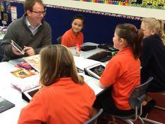 iPad Mini winner Heath Chittenden and students at Auroa School