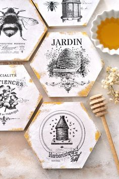 DIY French Honeycomb Gold Coasters - learn how to cut the hexagonal shapes, paint and faux distress with white and gold paint and easily decorate them with waterslide decal paper. Gold Coasters, Photo Coasters, Diy Coasters, Honeycomb Shape, Bee Honeycomb, Hexagon Shape, Gold Acrylic Paint, Faux Painting, Bee Crafts