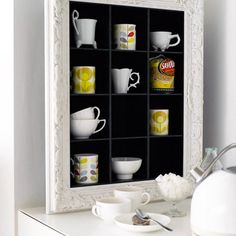 Frame it. Got something pretty to show off? A storage frame, like this one I found via Living etc, is fantastic for showing off cups and smaller items. This is from Heal's, but I bet an old frame, some plywood and a lick of paint would make a great DIY version, too.