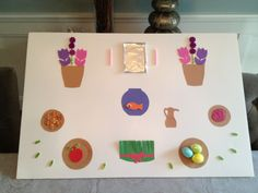 Haft seen craft for norouz - construction paper, stickers, adhesive foam, aluminum foil, candles, coins, colored sugar as sumac.