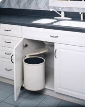 Round Pivot-Out Waste Container features an inner polymer container with built-in handle for easy removal.