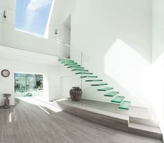 20 Glass Staircase Wall Designs With A Graceful Impact On The Overall Decor