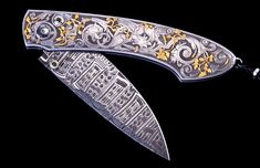 Spearpoint Fantasy by William Henry knives. The Spearpoint 'Fantasy' features a mesmerizing hand-engraved handle with carved 24K gold by Bram Ramon. The beautiful blade is hand-forged 'Windows' damascus steel by Chad Nichols; the one-hand button lock and the thumb stud are set with spinel.