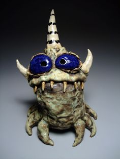 Website has a wide variety of these cute little critters - some are just decorative, some are toothbrush holders, spoon holders, etc. Ceramic Monsters, Clay Monsters, Funny Monsters, Clay Projects, Clay Crafts, Arte Black, Middle School Art Projects, Paper Mache Animals, Gothic Dolls