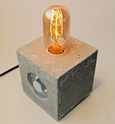 Concrete and Steel. Edison Lamp. Industrial, Nightlight, Table, Desk, Accent or Man Cave Light. Gifts for men.. $59.00, via Etsy.