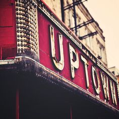 """The Uptown""- crimson red and silver photograph of a vintage theatre marquee"