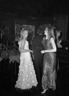 Paris,France:Catherine Deneuve(wearing a model by Christian Dior) and her sister Francoise Dorleac dancing in Club Saint Hilaire.December 1964.