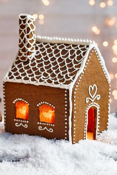 This dainty, pretty Swedish-style gingerbread house is so charming you'll want it to last all season long. | Tesco