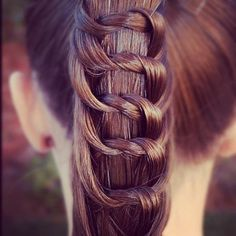 Note that alternately a strand of the braid comes from behind one side, twists on outside and rejoins the ponytail core on the opposite side. Get it?  ;-)