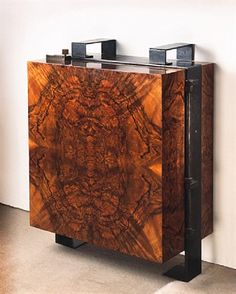 Wall Cabinet walnut veneer and frame in black wrought iron patina, opening on a sycamore inside with open eight niches and drawers by Pierre Chareau