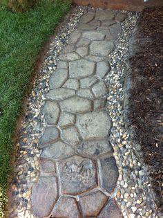 @Jess Meade  concrete cobblestone and pebble mosaic path