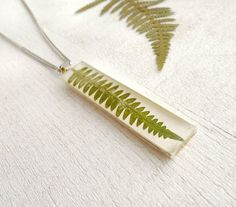 Pressed Fern Necklace - green preserved in epoxy resin - handmade resin jewelry. $25.00, via Etsy.