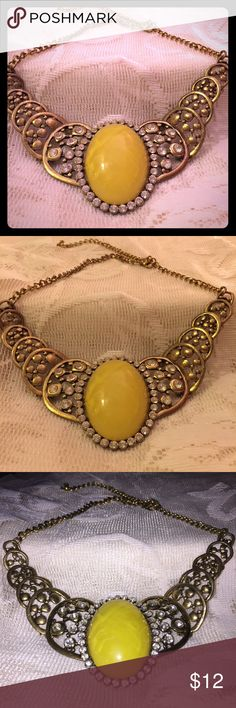Gypsy BoHo yellow stone statement necklace Beautiful yellow stone statement necklace. Very bohemian and would be the perfect accessory with any outfit.   ~Be sure to check out my other listings for more great items & save on shipping! ~ I am open to reasonable offers. ~I ship same day or next day.  ~ I do not hold items.   ~Not responsible for incorrect sizing. I go by what the tag says its up to the buyer to know their size. Jewelry Necklaces