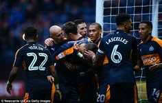 The Newcastle players congratulate their striker after another productive afternoon