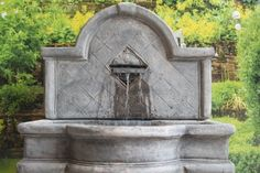 Large stone wall fountain.  self contained outdoor ornate garden water feature.