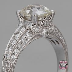 This Old Mine cut Diamond Engagement Ring in Edwardian style is certified and crafted in solid 18K white gold, weighs 4.7g and measures 8mm wide and 7mm deep. Reminiscent of the distinctly elegant Edwardian Jewelry style,     www.faycullen.com...
