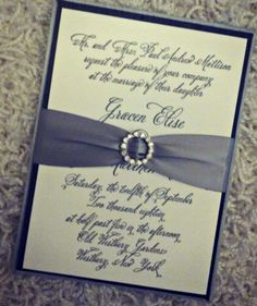 silver silk folio with satin ribbon and bling buckle for wedding invitations from Chic Ink