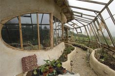 tour of Simon Dales cob house-- I especially love the whole side of the house is a greenhouse!!!