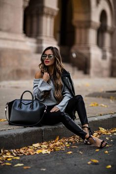 OCTOBER 19TH, 2017 BY MARIA How To Wear Leather As Daywear This Fall - OUTFIT DETAILS: Shopbop Off Shoulder Ruffle Sweater Blank Denim Vegan Leather Pants Similar Bow Heels Quay x Desi Perkins Sunglasses Similar Leather Jacket