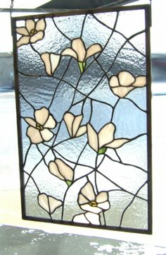 "PIPER :: Give her flowers that will last forever; she'll love the blush pink. ""Magnolia"" Arts & Crafts style panel by artist Lori Ann Hallstrom. Stained Glass. Piper Custom Framing & Fine Art Gallery, Sioux Falls, South Dakota."
