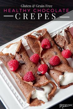 Healthy chocolate crepes  - a gluten free and grain free recipe. It's filled with a protein packed greek yogurt and whipped cream mixture and topped with raspberries and dark chocolate. Add this to your healthy breakfast recipes and healthy dessert recipe board! | thebewitchinkitchen.com
