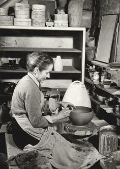 Lucie Rie potting on the wheel in her studio at Albion Mews, Photographer: unknown