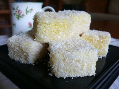 Lamingtons (the word always reminds me of those rodents, lemmings), those Aussie treats made from leftover butter or sponge cakes, are perfe. Lemon Recipes, Sweet Recipes, Cake Recipes, Dessert Recipes, Aussie Food, Australian Food, Australian Recipes, Mini Cakes, Cupcake Cakes