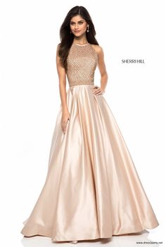 1432992854f4 Halter neck satin ball gown from the Sherri Hill 2018 collection. We love  the nude