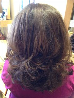 Medium hair cut with lots of layering and texture.