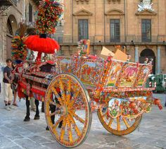 Sicilian carriage - every once in a while you'll see one of these fancy bad boys going down the street like it's no big deal! ~Saucy