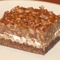 Deluxe Chocolate Marshmallow Bars recipe -- a bar cookie w/ thin cookie base, & layer made up of marshmallow topped w/crisp rice cereal & peanut butter mixture. Chocolate Oat Bars Recipe, Chocolate Oats, Chocolate Marshmallows, Melting Chocolate Chips, Chocolate Pudding, Chocolate Recipes, Rice Crispy Treats, Yummy Treats, Sweet Treats