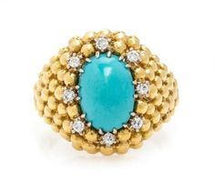 * An 18 Karat Yellow Gold, Turquoise and Diamond Ring, Van Cleef & Arpels, in a beaded bombe design, containing one oval cabochon cut turquoise