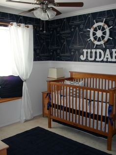 nautical nursery- love the wall art. Awesome way to get a ton of boats on the wall...