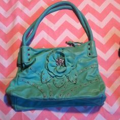 Teal bling flower purse!!! Very cute teal purse, with bling!!! :D very nice, fits quite allot of stuff inside :), the inside zipper pocket got a test in lining, but safety pin holds it just fine. :). Has some wear but in good condition :D!! Bags Shoulder Bags