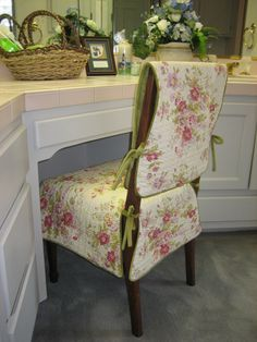 This is my Reversible Tie-On Chair Suit® and is made of a pre-quilted rose patterned print with a reverse side of apple green velvet.  Ties are created from the apple green velvet.  Each set is custom made to fit your chair and can be made in your choice of alternate fabrics.  As shown is dry clean only.