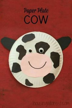 Paper plate cow using pink and black construction paper googly eyes a black marker and a paper plate