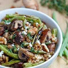 Roasted Mushroom and Green Bean Farro Salad Recipe Salads with water, farro, mushrooms, green beans, oil, thyme, salt, pepper, feta cheese, walnuts, balsamic vinaigrette, thyme