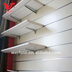 wood shelves for shop fitting Wood Shelves, Display Shelves, Shelving, Mobile Shop Design, Fashion Retail Interior, Shoe Store Design, Shop Fittings, Slat Wall, Wood Laminate