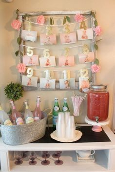 A pink and white floral themed first birthday party with touches of gold glitter and lots of sweets and cake stands designed by Kristyn Cole of At Home With Kristyn Cole for her daughter Karsyn.:
