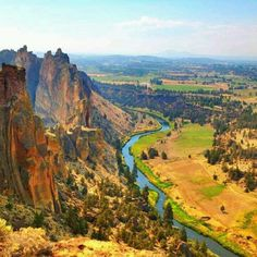 The Deschutes River slowly makes its way along the base of the Smith Rocks toward the rugged Crooked River Gorge in Terrebone, Oregon and 10 miles southeast of Redmond and Bend, Oregon.