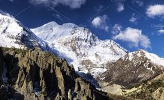 Mountain landscape in the Nepal Photos High mountain ridge in the Nepal. Beautiful natural mountain landscape in the summer time by biletskiy