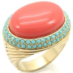 Gorgeous Semi Precious Coral Stone Ring with Blue Crystals surrounding it. -Brass ring Gold plate -semi precious coral stone -blue cyrstals Available in sizes: Coral And Gold, Coral Turquoise, Mint Coral, Mint Green, Rose Gold, Coral Stone, Turquoise Stone, Turquesa E Coral, Bling Bling