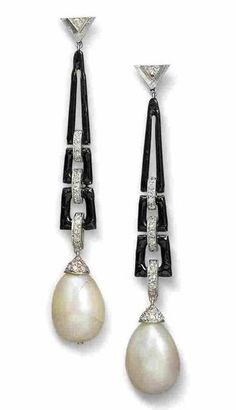 A Pair of Art Deco Natural Pearl, Diamond, Enamel and Platinum Earrings. The natural pearl drops, with diamond-set caps, suspended from openwork black enamelled frames with diamond-set links.