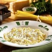 """Olive Garden"" Alfredo  1 8oz. package of cream cheese  1 stick butter or margarine  1/2 cup milk  3/4 cup grated parmesan cheese  8 oz. dry fettuccine noodles"