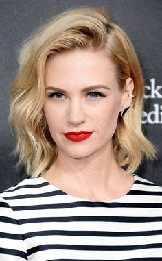 January Jones goes for retro beauty with a thick winged eye, classic matte red lips, and bold brows!