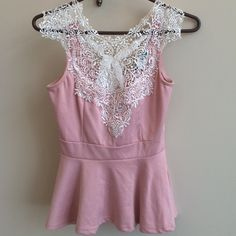 Gorgeous Crochet Tank with Bow. So cute! Pale pink tank with gorgeous crochet detail at neckline. Pleated bottom. Cute bow in back. Tops Tank Tops