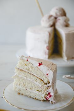 This strawberry milkshake cake is my Aunt Tina's buttermilk cake, I topped with strawberry buttercream frosting and giant scoops of ice cream with a straw.