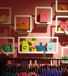 Colorful Vintage Camera Display: Makes you want to find old cameras and spray paint them in bright colors!