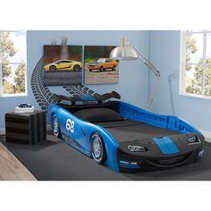 Designed to resemble a classic race car, this twin bed features fun details include a rear spoiler, a front grill and racing tires with chrome-colored rims. The high sides of the race car act as secur